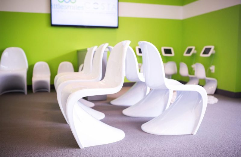 curved chairs in the costa family and cosmetic dentistry patient waiting room