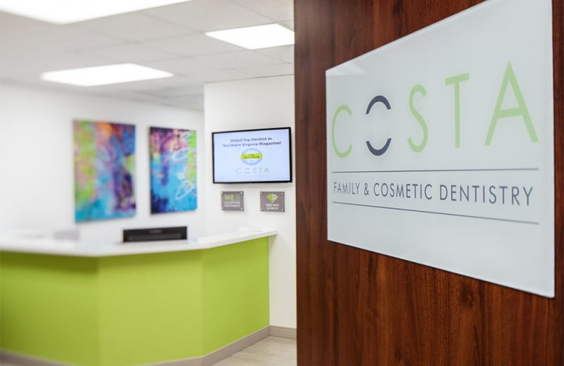 costa family and cosmetic dentistry entrance with the logo on the front door