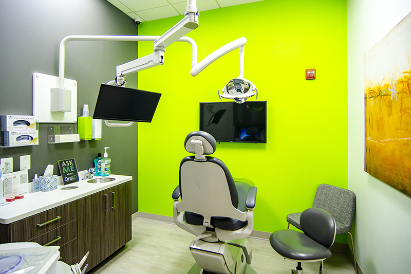 costa family and cosmetic dentistry examination room with a tv